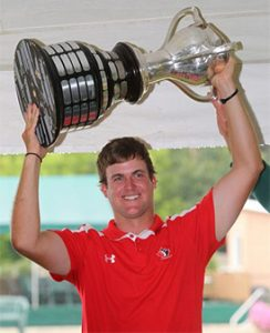 Canadian Taylor Pendrith lifts the Porter Cup Trophy - Stanley Cup style - after his win.  (Matthew Masin/Buffalo News)