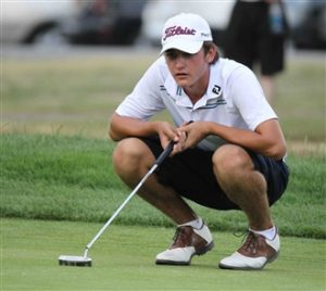 Will Thomson lines up a putt on the ninth hole (James P. McCoy/Buffalo News)