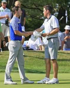 Gavin Hall congratulates Harrison Endycott, winner of the 2016 Porter Cup at Niagara Falls Country Club. (Harry Scull Jr./Buffalo News)